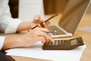 close up on man hand pressing on calculator for calculating cost estimating , senior accountant job working concept